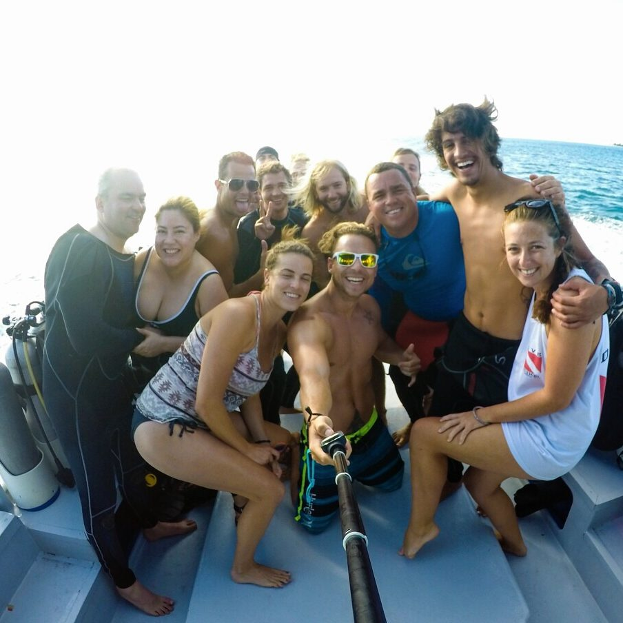 Happy fun divers selfie on the boat at Alton's Dive Center, Utila