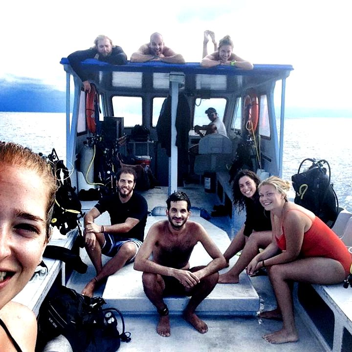 Happy fun divers on the boat at Alton's Dive Center, Utila